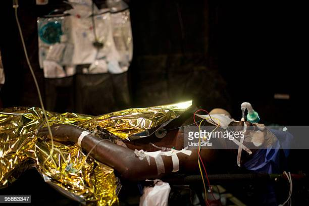 Haitian lies in the recovery tent just after undergoing surgery at the Israeli army hospital on January 19, 2010 in Port-au-Prince, Haiti....