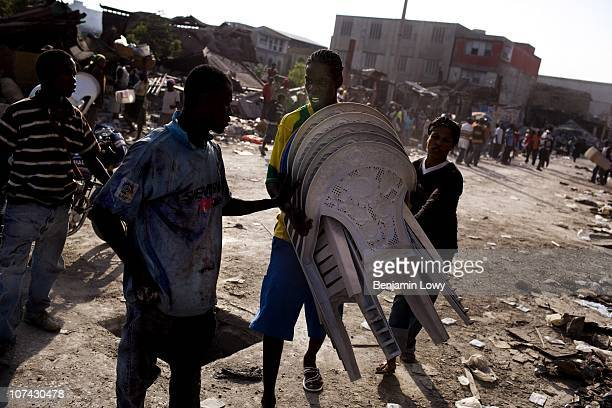 Haitian looters scavenge and clash over anything they can save from stores in earthquake ravaged downtown Port au Prince on February 4 2010. Haiti...