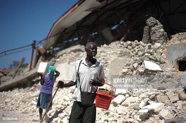 A Haitian man passes by the devastated main church in the coastal city of Leogane on February 23 2010 The town of Leogane an hour outside the capital...