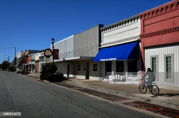 Haitian man rides his bike in downtown Mount Olive The city of Mount Olive had about 4600 people but swelled to about 1500 more as Haitians relocated...