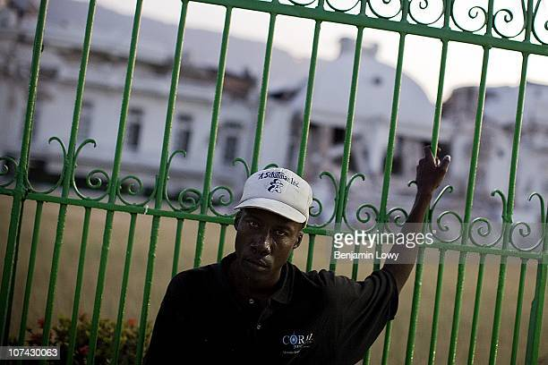 Haitian man stands outside the remains of the destroyed Haitian National Palace in downtown Port au Prince. On January 12, 2010 Haiti was struck by a...