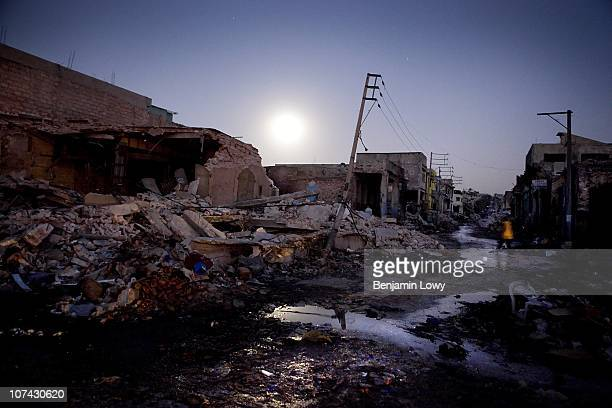 Haitian man wanders through the moon-lit remains of earthquake ravaged downtown Port au Prince, Haiti. On January 12, 2010 Haiti was struck by a...
