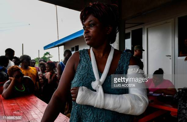 Haitian migrant MarieClaudia Toussaint waits for medical assistance at the Temporary Station of Humanitarian Assistance in La Penita village Darien...