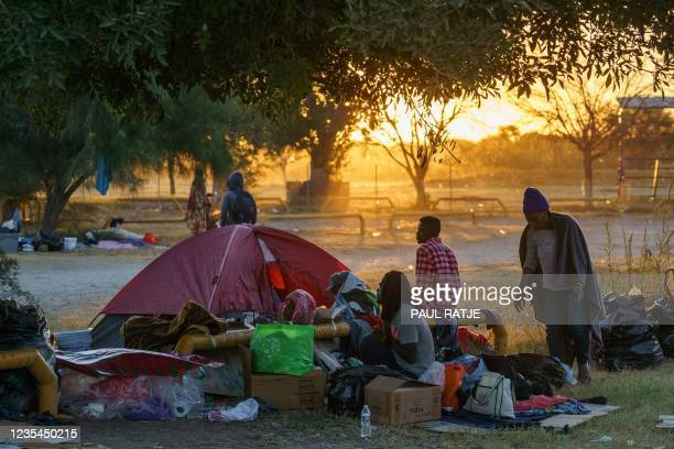 Haitian migrants camp at Parque Ecologico Braulio Fernandez in Ciudad Acuna, Coahuila state, Mexico, after they abandoned a large camp in Del Rio,...