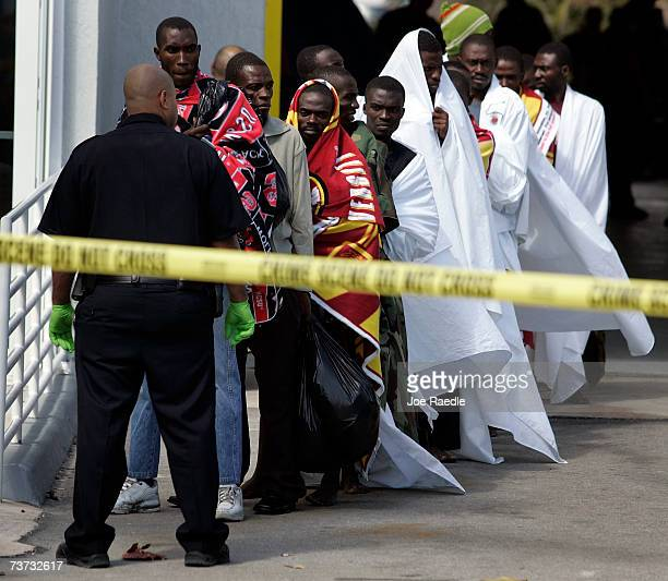 Haitian migrants line up for transportation to a Border Patrol processing center March 28 2007 in Hallandale Beach Florida More than 100 Haitians...