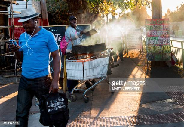 Haitian migrants living in Chile are pictured in the commune of Quilicura in Santiago on April 24 2018 Chilean President Sebastian Pinera recently...