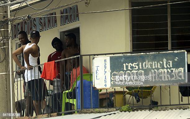 Haitian migrants rest in a hotel in the Turbo municipality Antioquia department Colombia on June 15 2016 Haitians are in the country after Panama...