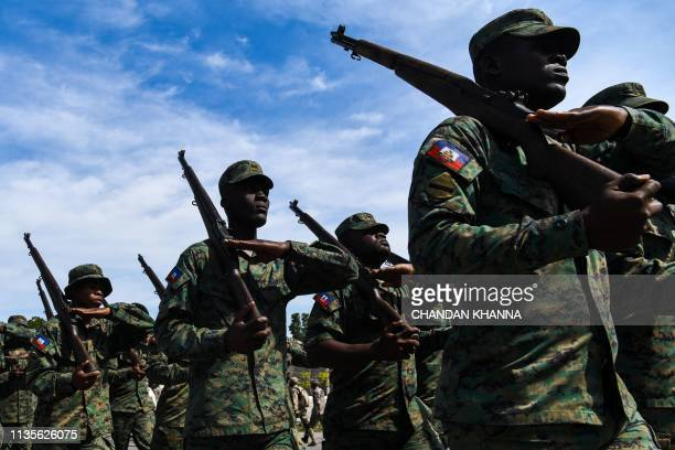 Haitian military personnel march during a ceremony to commemorate the death of Toussaint Louverture in the Haitian capital PortauPrince on April 7...