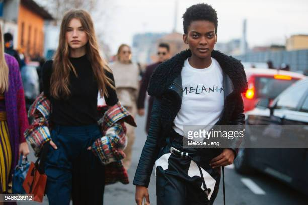 Haitian model Aube Jolicoeur wears a black leather jacket and 'MELANIN' tshirt in the Friends font and a black leather skirt during Milan Fashion...