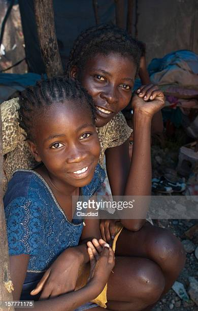 Haitian mother with daughter in refugee camp