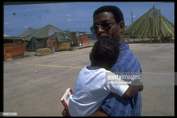 Haitian orphan, unaccompanied refugee minor being held re immigration policy decision w. Community Relations Services rep., at US Guantanamo Bay...