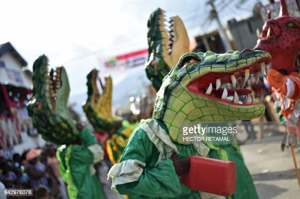 Haitian people with animal masks take part in the Carnival of Jacmel 95 km from PortauPrince February 19 2017 The city on southern coast of Haiti...