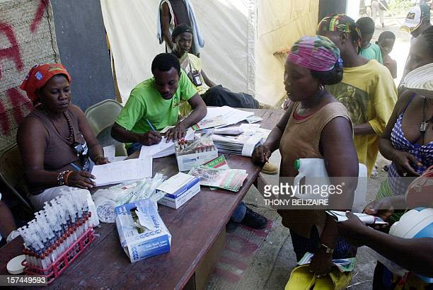 Haitian pilgrims take an opportunity to be tested for AIDS 16 July 2007 before attending a Voodoo pilgrimage and festival of the Miracle Virgin of...