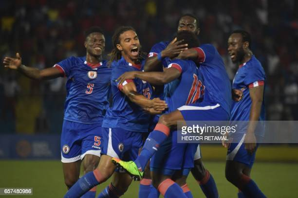 Haitian players celebrate a goal scored by Jeff Louis against Nicaragua during the first of two match to define the last qualified to the 2017 Gold...