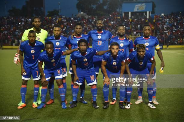Haitian players pose for a picture before the start of the match against Nicaragua at the Sylvio Cator Stadium in PortauPrince on March 24 the first...