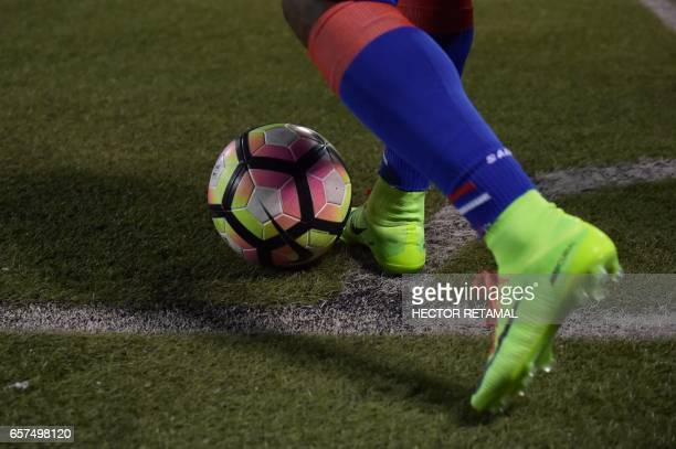 Haitian players prepares to kicks the ball during the match against Nicaragua at the Sylvio Cator Stadium in PortauPrince on March 24 the first of...