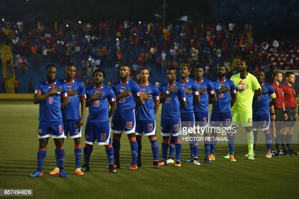 Haitian players sing their hymn during the match against Nicaragua at the Sylvio Cator Stadium in PortauPrince on March 24 the first of two match to...