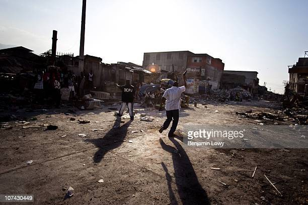 Haitian police and looters clash in the earthquake ravaged downtown Port au Prince on February 4 2010. Haiti was struck by a magnitude 7 earthquake...