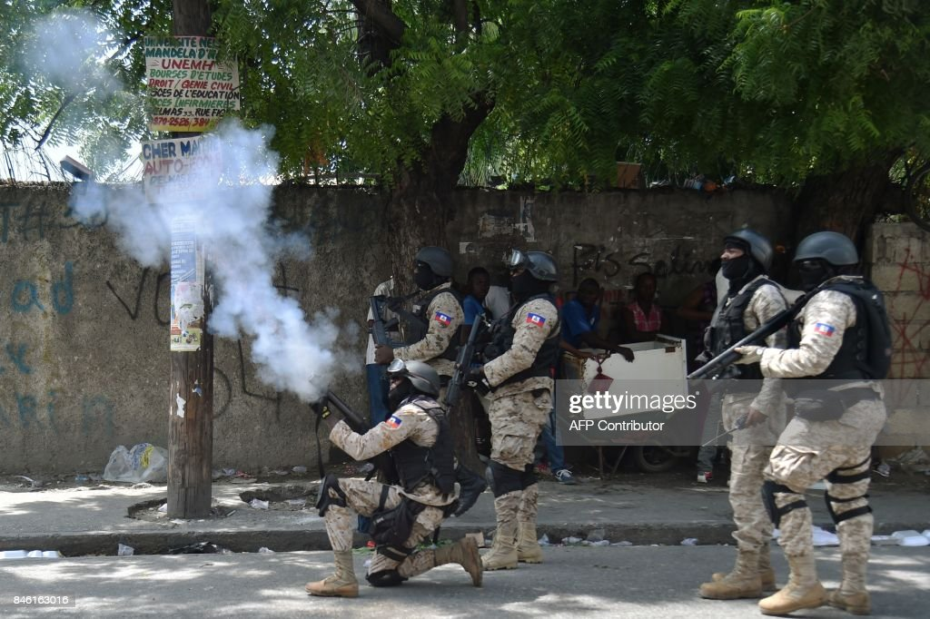 Haitian police fire tear gas to disperse protesters during an anti-government demonstration in the centre of the Haitian capital Port-au-Prince, on September 12, 2017. Demonstrators took to the streets to protest against the government and the new budget for 2017-2018, throwing stones at the police, setting tires on fire and blocking some streets. /