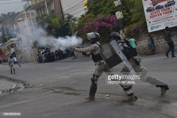 TOPSHOT Haitian police fire tear gas towards demonstrators in clashes during a protest in PortauPrince on November 23 demanding the resignation of...