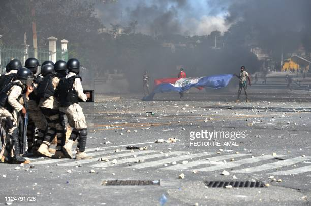 Haitian Policie are trying to disolve a protest in front of the National Palace in the centre of Haitian Capital PortauPrince on February 13 on the...