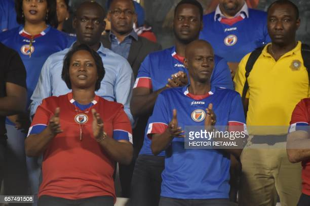 Haitian President Jovenel Moise is seen during the macth of Haiti against Nicaragua at the Sylvio Cator Stadium in PortauPrince on March 24 the first...