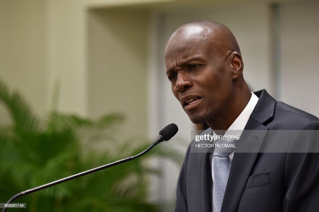 Haitian President Jovenel Moise speaks on March 13, 2017 in Port-au-Prince offering condolences to the families of victims in the road accident that took the lives of 38 persons the previous day in...