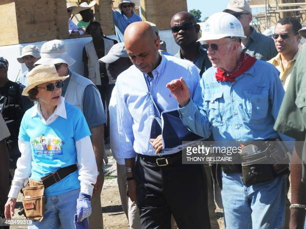 Haitian President Michel Martelly and former US President Jimmy Carter visit a housing project on November 8 2011 in Leogane which built by Carter...