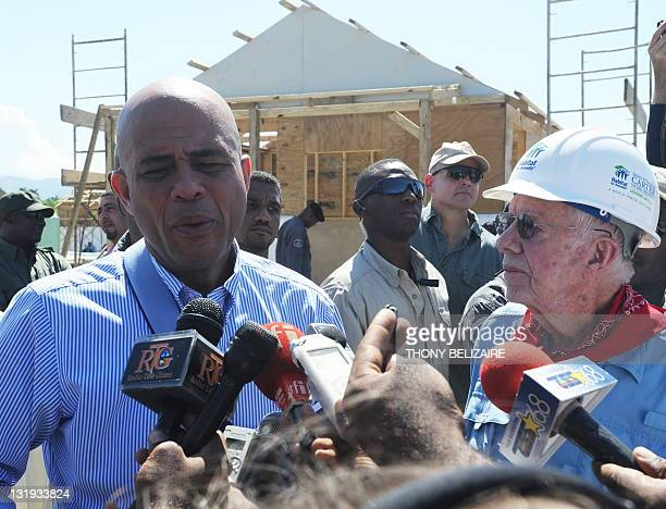 Haitian President Michel Martelly and former US President Jimmy Carter meet the press while visiting a housing project on November 8 2011 in Leogane...
