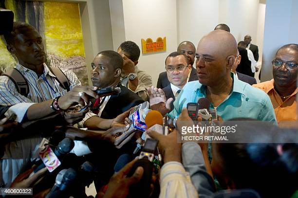 Haitian President Michel Martelly speaks to reporters as he departs following meetings with members of opposition parties Port-au-Prince, on December...