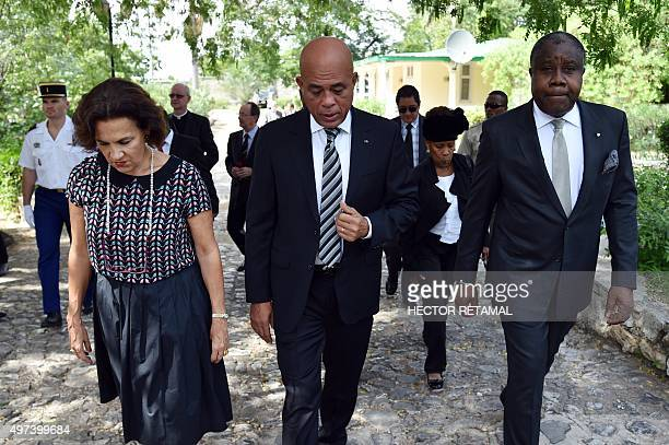 Haitian President Michel Martelly walks with French Ambassador to Haiti Elisabeth Beton Delègue November 16 2015 in PortauPrince before a memorial...