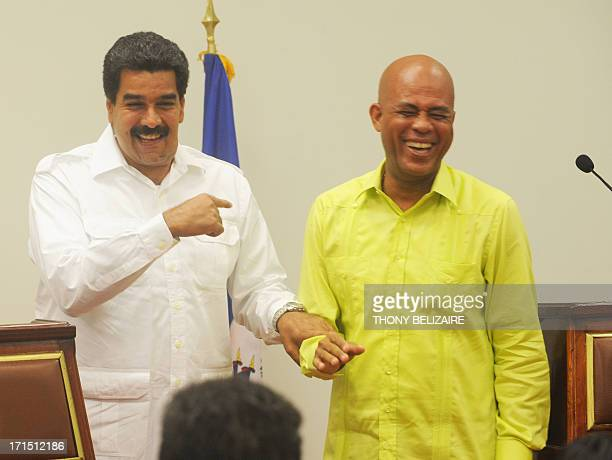 Haitian President Michel Martelly welcomes Venezuelian President Nicolas Maduro on June 25 2013 at the presidential palace in PortauPrince Haiti...