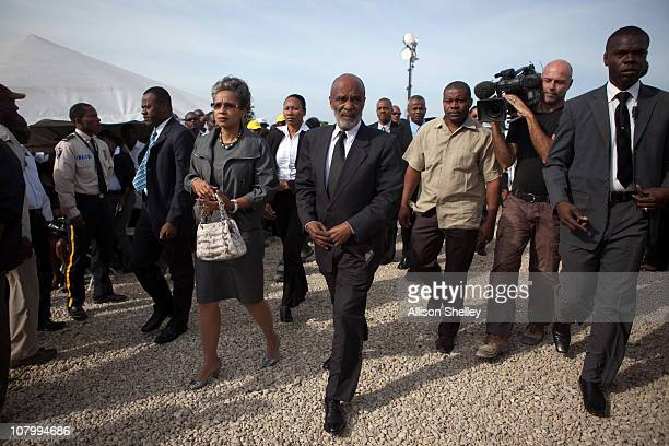 Haitian President Rene Preval and his wife Elisabeth Delatour Preval arrive to a service to commemorate those killed in the January 12 2010...