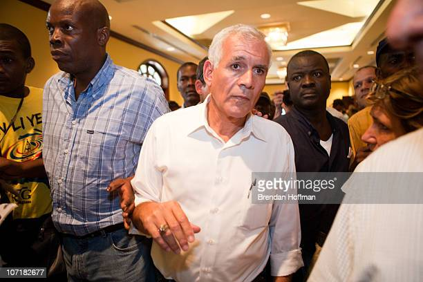 Haitian presidential candidate Charles Henry Baker leaves a news conference on November 28 2010 in PortauPrince Haiti Following widespread...