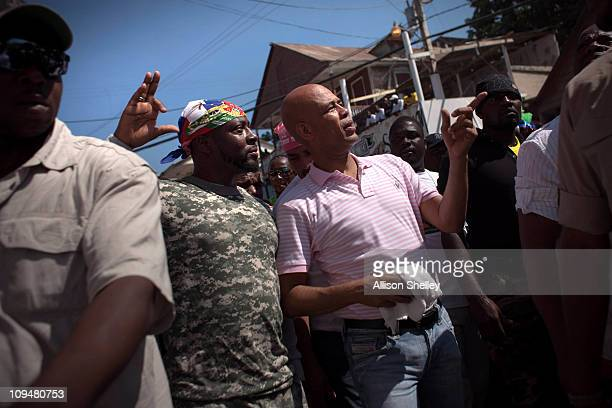 Haitian presidential candidate Michel Martelly and entertainer Wyclef Jean who has endorsed his campaign greet supporters during carnival weekend in...