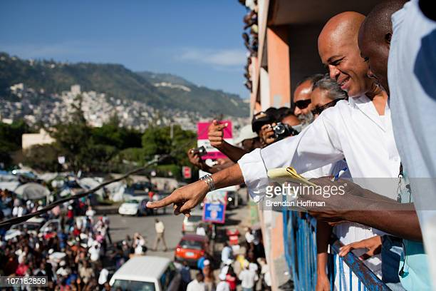 Haitian presidential candidate Michel Martelly arrives to cast his ballot during national election day on November 28 2010 in PortauPrince Haiti...