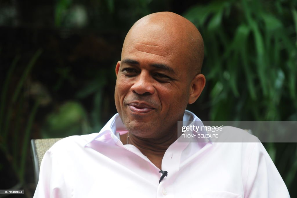 Haitian presidential candidate Michel Martelly is interviewed by AFP on December 15, 2010 in the garden of his private residence in Peguy-ville, near Port-au-Prince. Days of street protests erupted when official results last week showed popular singer Michel Martelly, 49, losing out on a place in the January 16 run-off to Celestin by fewer than 7,000 votes.There were widespread allegations of fraud on a chaotic election day in which thousands of quake survivors and slum dwellers either couldn't get the necessary papers to vote or weren't on the register. AFP PHOTO/Thony BELIZAIRE