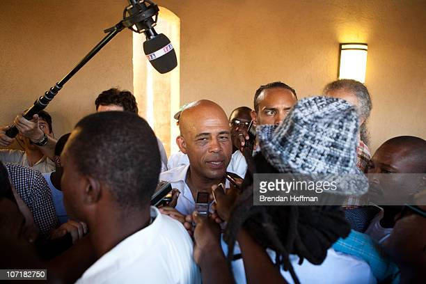 Haitian presidential candidate Michel Martelly is surrounded by the media as he leaves a news conference during national election day on November 28...