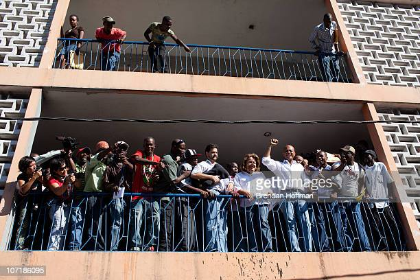 Haitian presidential candidate Michel Martelly rallies the crowd after casting his ballot on November 28 2010 in PortauPrince Haiti Following...