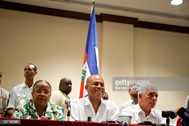 Haitian presidential candidates Mirlande Manigat Michel Martelly and Charles Henry Baker attend a news conference on November 28 2010 in PortauPrince...