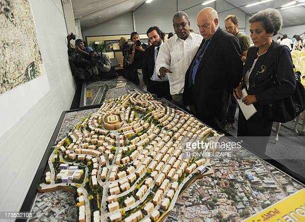 Haitian Prime Minister JeanMax Bellerive explains January 17 the Haiti reconstruction projects to OAS General Secretary Miguel Insulza one year after...