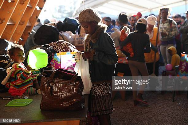 Haitian refugees look over donated items at an immigrant center on September 24 2016 in Tijuana Mexico In recent months a surge of Haitian refugees...