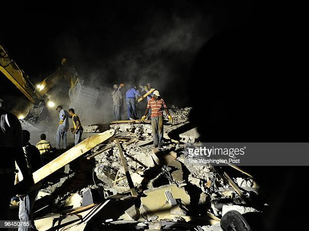Haitian rescuers work to rescue people trapped in the rubble from the earthquake on January 13 2010 in PortauPrince Haiti