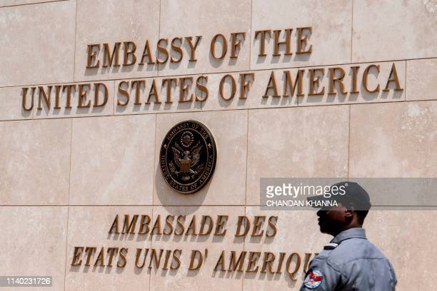 Haitian security personnel guard outside the US Embassy in the Haitian capital Port-au-Prince on April 29, 2019. - The US embassy in Haiti reported...