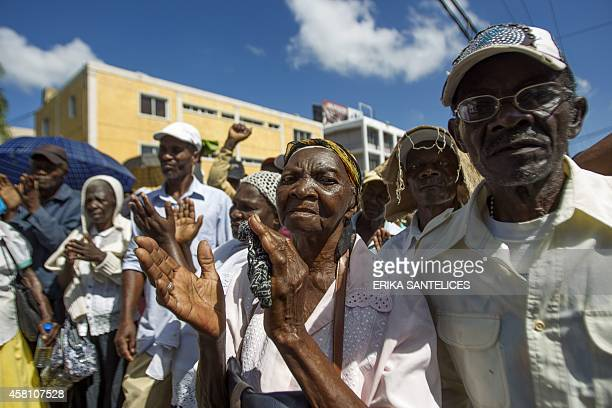 Haitian sugar cane workers take part in a march towards Haitian embassy demanding Haitian passports needed to regularize their migration status in...