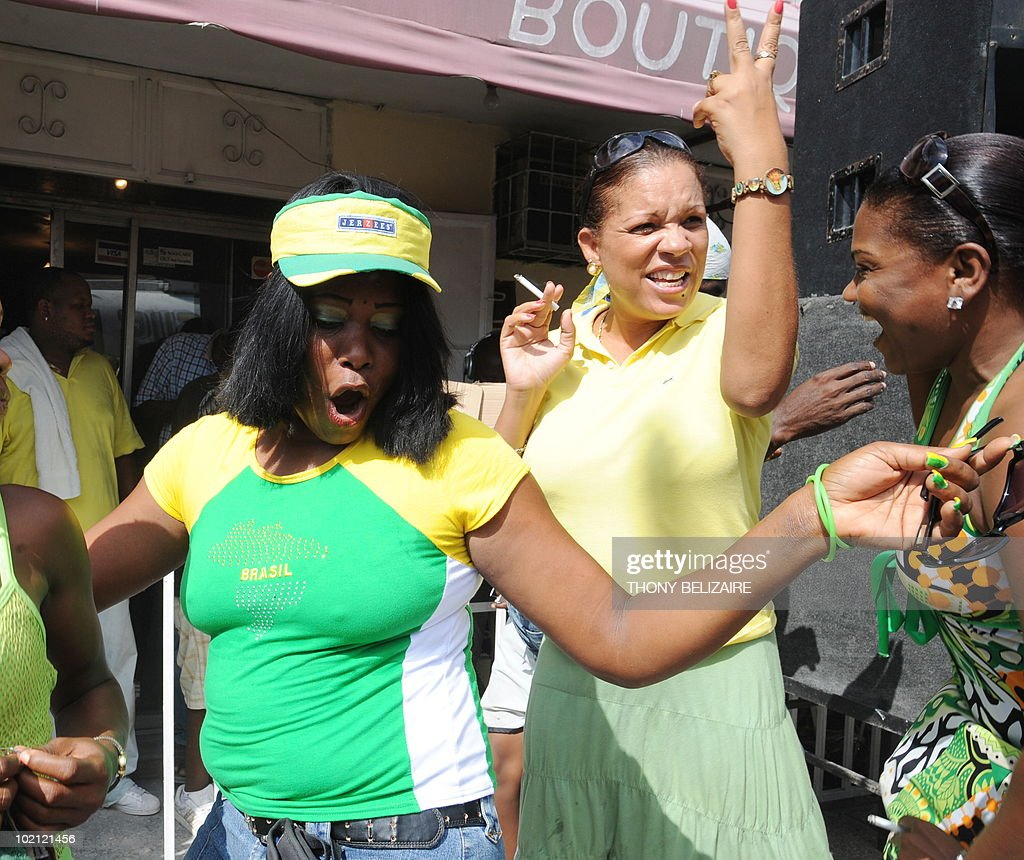 Haitian supporters of team Brazil celebrate June 15 2010 after they defeated North Korea 2-1 in their World Cup soccer match. AFP PHOTO Thony BELIZAIRE.