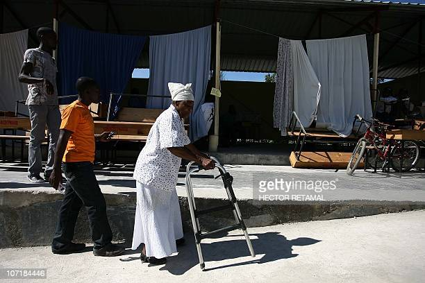 Haitian voters enter the polling station in Leogane south of PortauPrince on November 28 2010 Twelve of the 18 candidates for Haiti president...