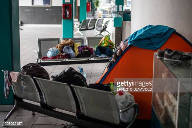 A Haitian woman and her daughter sit in a tent installed at a bus station in Lima on July 10 2020 On March 16 2020 the order of compulsory national...