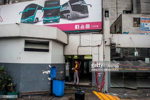 A Haitian woman cleans a pot outside a makeshift kitchen at the baggage claim area of a bus station in Lima on July 10 2020 On March 16 2020 the...