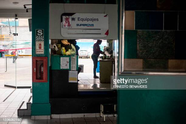 A Haitian woman cooks in a makeshift kitchen at the baggage claim area of a bus station in Lima on July 10 2020 On March 16 2020 the order of...